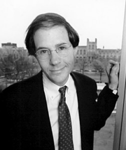 Harvard Law Professor Cass Sunstein leaning suggestively on a doorframe